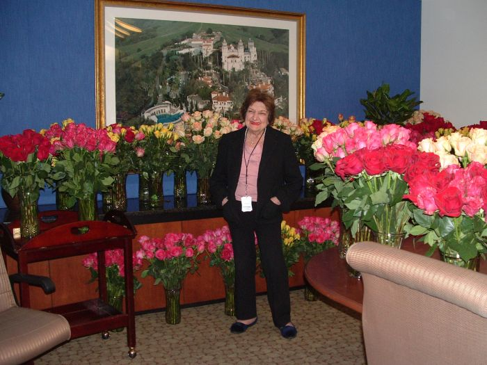 Helen Thomas, surrounded by a rich and fragrant reward